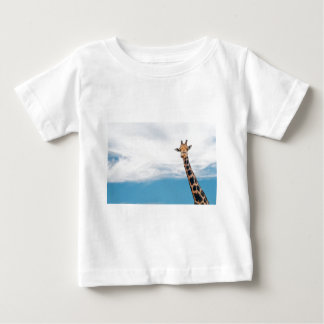 Giraffe neck and head against the clear blue sky baby T-Shirt