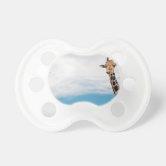 Giraffe neck and head against the clear blue sky pacifier