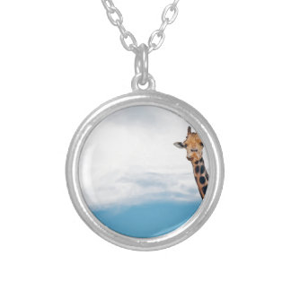 Giraffe neck and head against the clear blue sky silver plated necklace
