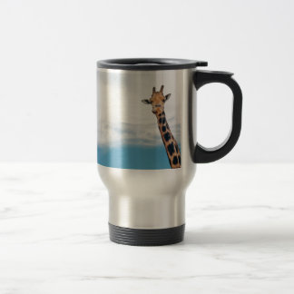 Giraffe neck and head against the clear blue sky travel mug