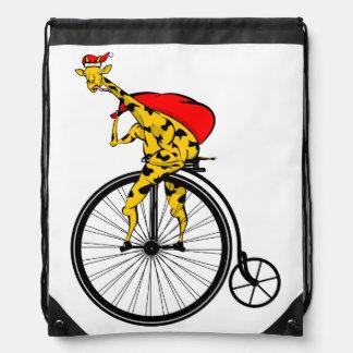 Giraffe riding a bike Santa Claus Christmas Drawstring Bag