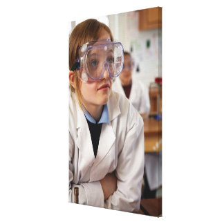 Girl (9-12) wearing protective goggles in canvas print