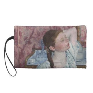 Girl Arranging Her Hair by Mary Cassatt Wristlet Purses