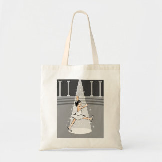 Girl dancing ballet amusingly in the theater tote bag