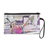 Girl Exercising in Gym Wristlet
