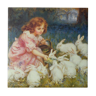 Girl feeding rabbites tile