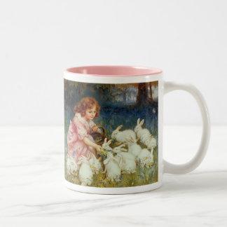 Girl feeding Rabbits Two-Tone Coffee Mug