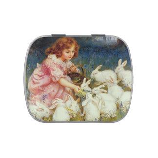 Girl feeding white rabbits
