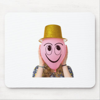 Girl holding balloon with smiling face and hat mouse pad