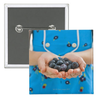 Girl holding fresh blueberries 2 inch square button