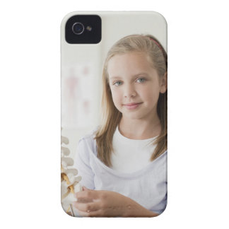 Girl holding model of spine in doctors office iPhone 4 Case-Mate case