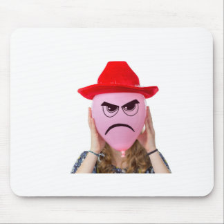 Girl holding pink balloon with angry face and hat mouse pad
