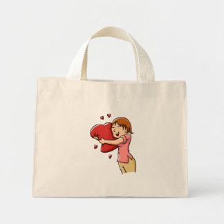 Girl hugging heart mini tote bag