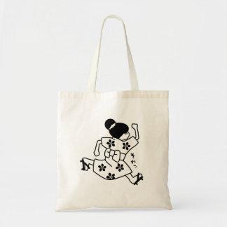 Girl in a kimono running tote bag