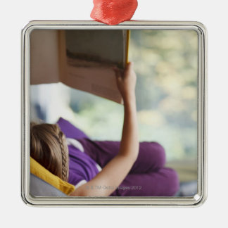 Girl laying down reading book Silver-Colored square ornament