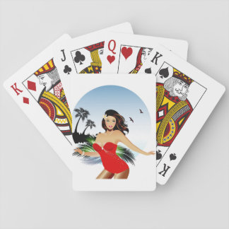 Girl on beach in red bathing suit playing cards