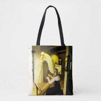 Girl playing harp tote bag