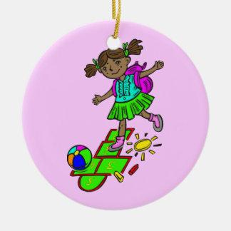 Girl Playing Hopscotch Round Ceramic Ornament