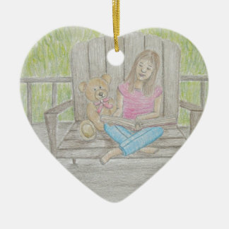 girl reading ceramic heart ornament