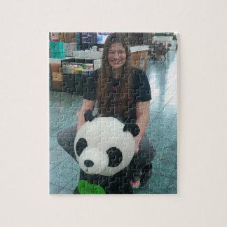 Girl riding a panda bear jigsaw puzzle