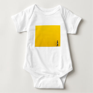 Girl Walking Against Enormous Yellow Wall Baby Bodysuit
