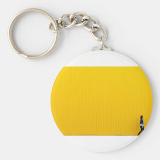 Girl Walking Against Enormous Yellow Wall Keychain