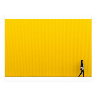 Girl Walking Against Enormous Yellow Wall Postcard