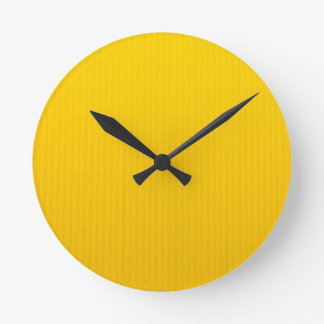 Girl Walking Against Enormous Yellow Wall Round Clock