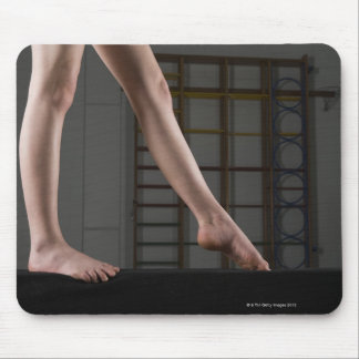 Girl walking on balance beam mousepad