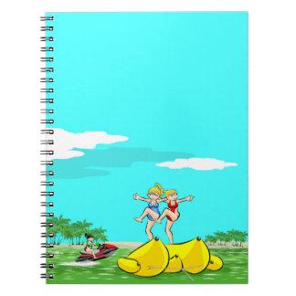 Girls amusing itself in the beach notebook