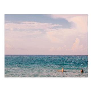 Girls surfboarding in an ocean postcard