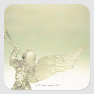 Glass angel playing trumpet, rear view square sticker