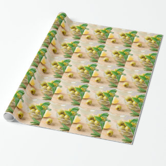 Glass cup with green pitted olives wrapping paper