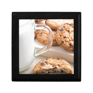 Glass cup with milk and oatmeal cookies gift box