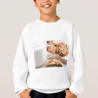 Glass cup with milk and oatmeal cookies sweatshirt