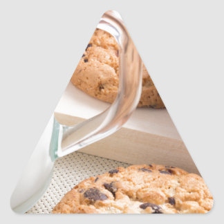 Glass cup with milk and oatmeal cookies triangle sticker