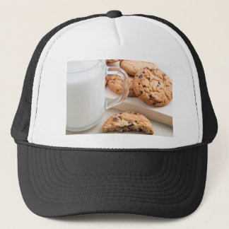 Glass cup with milk and oatmeal cookies trucker hat