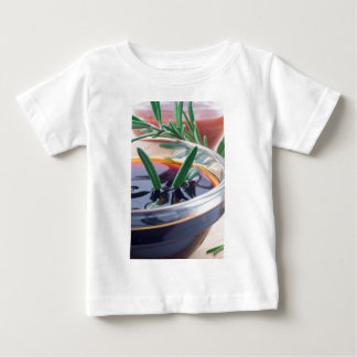 Glass cup with soy sauce and rosemary baby T-Shirt