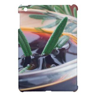 Glass cup with soy sauce and rosemary case for the iPad mini