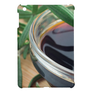 Glass cup with soy sauce and rosemary leaves close cover for the iPad mini