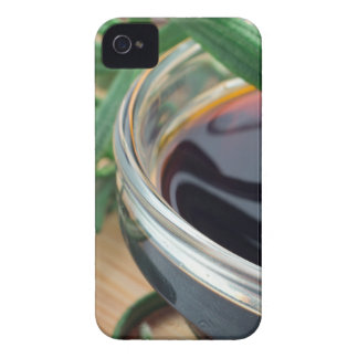 Glass cup with soy sauce and rosemary leaves close iPhone 4 cases