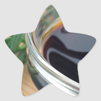 Glass cup with soy sauce and rosemary leaves close star sticker