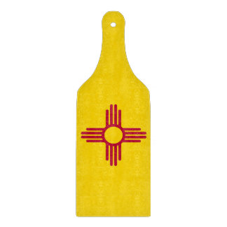 Glass cutting board paddle with New Mexico flag