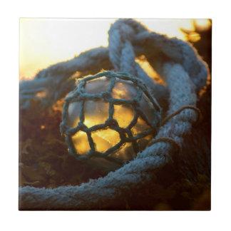 Glass float glows at sunset, Alaska Tile