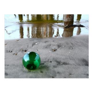 Glass float under pier postcard