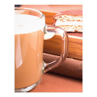 Glass mug with hot chocolate and biscuits letterhead