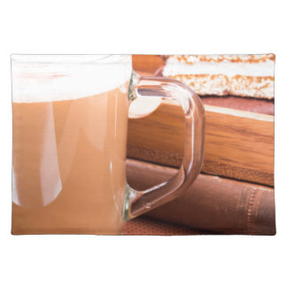 Glass mug with hot chocolate and biscuits placemat