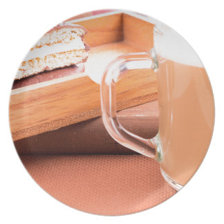 Glass mug with hot chocolate and biscuits plate