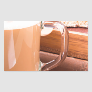 Glass mug with hot chocolate and biscuits sticker