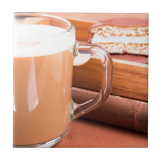 Glass mug with hot chocolate and biscuits tile